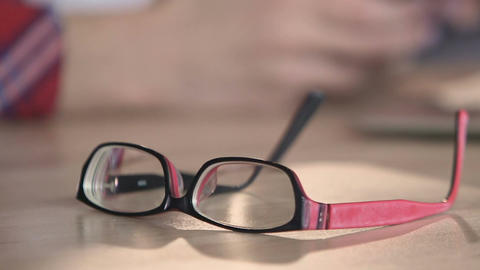 Closeup of eyeglasses on table, nice accessories for person with bad eyesight Footage