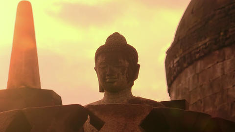 Statue of meditating Buddha. Ancient Borobudur Buddhist temple. Java Indonesia Footage