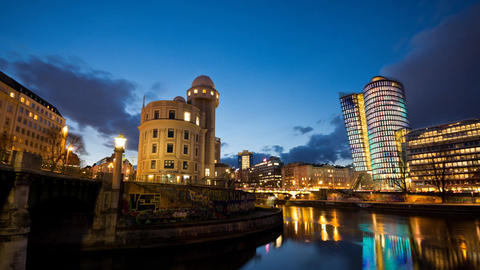 Time-lapse of Vienna evening cityscape on the Danube Canal Footage