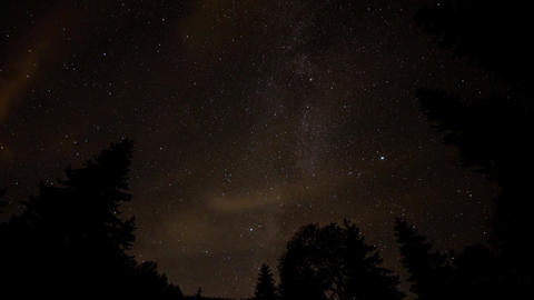 Timelapse at night of milkyway galaxy stars and clouds above mountain forest Footage