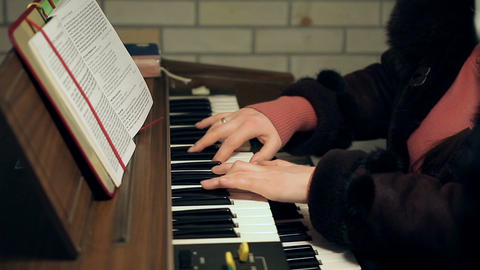 Adult woman's hands playing an old antique organ Footage