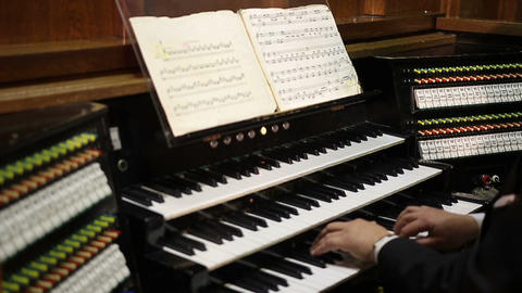Close up view of organist playing pipe organ