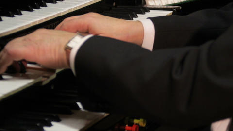 Organist playing 3 keyboards and pipe organ Footage