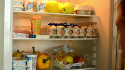 man can not decide what to take out of the fridge Footage