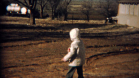 1961: Kid spins a remote controlled plane around himself Footage