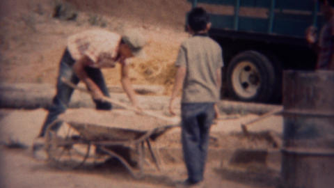 1959: Boy's hand mixing construction concrete outdoors Footage