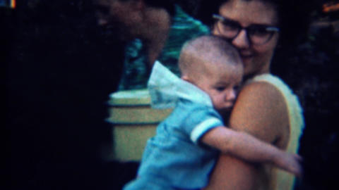 1959: 50's style mother shows off cute baby boy Footage