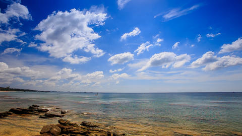 Stones in Transparent Shallow Azure Sea Blue Sky White Clouds Footage