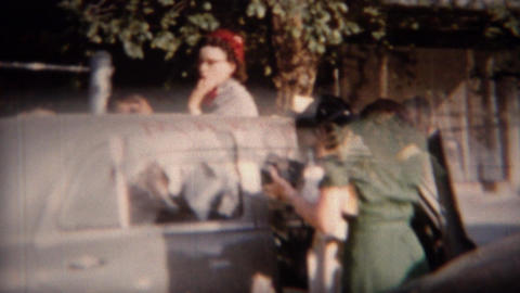 1951: Just Married decorations on new gray Plymouth car Footage