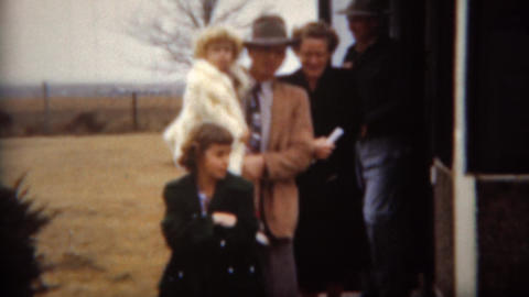 1951: Farmer family leaving house for Sunday church Footage