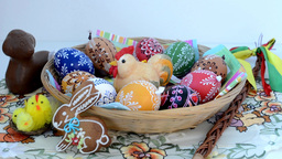 Easter decoration - chocolate ram with painted eggs and other decorations Footage