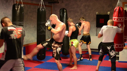 men do sport - combat sports (boxing in the bag) - in gym Live Action