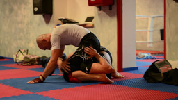 men do sport - combat sports (fighting men) - in gym Stock Video Footage