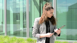 Business woman look to clipboard(paper) before business building Footage