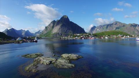Flight above fjord in Reine, Lofoten islands, Norway Footage