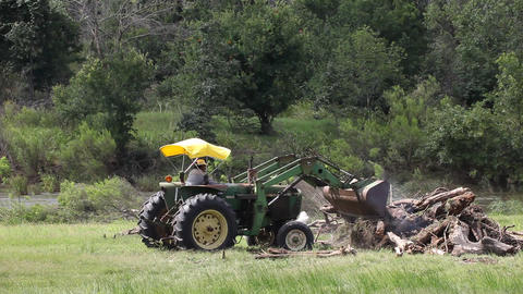 Tractor pushing debris Live Action