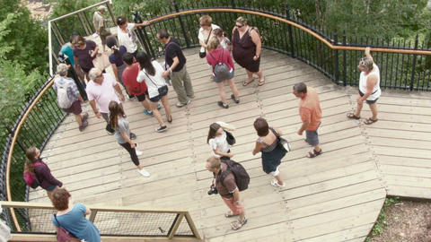 Tourists visiting walking on stairs platform Footage