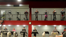 People doing sports, running on machines in fitness, gym. Workout Footage