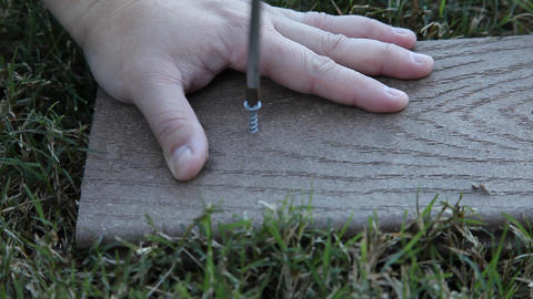 Man unscrewing a screw from wood Footage