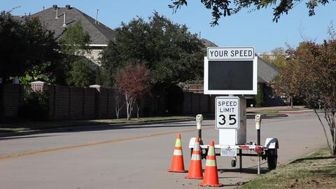 Cars speeding by police radar sign Footage