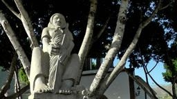 Spain Gran Canary Fataga 032 statue of old woman on churchyard Footage