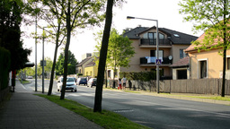 Urban street in the city with houses and trees Footage