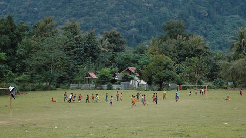 Street scene with children playing football Footage
