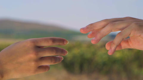 Man's hand and woman's hand are slowly approaching the one to the other Footage