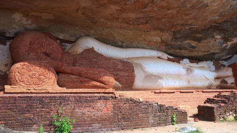 Reclining Buddha sculpture in Pidurangala Cave Temple. Sigiriya, Sri La nka Footage