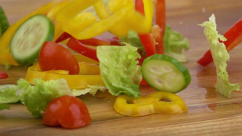 Slices of Ripe Vegetables are Falling on the Table Footage