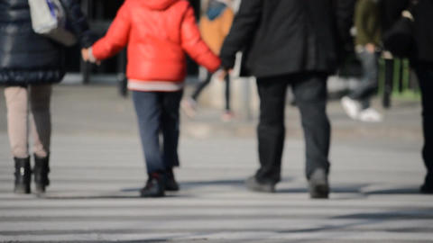 Happy Family with Child Walk the Sidewalk Together Stock Video Footage