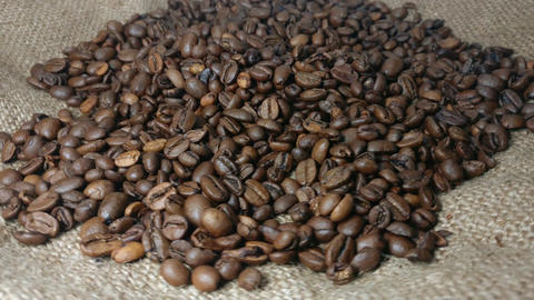 Rotating Background Of Roasted Coffee Beans Footage