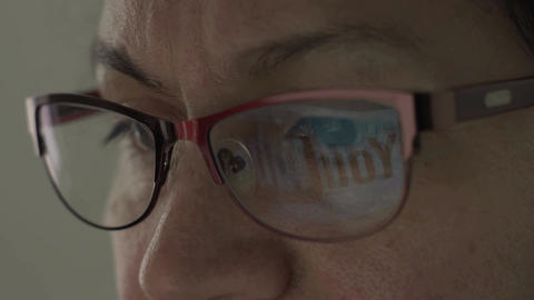Youtube Logo Reflection in Glasses of Middle Aged Female Footage