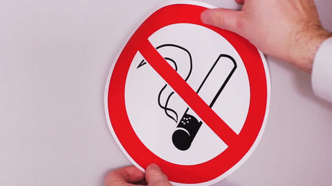 No smoking sign. Installation of vinyl stickers