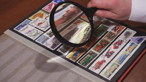 Philately. Browsing pages of stockbook Footage