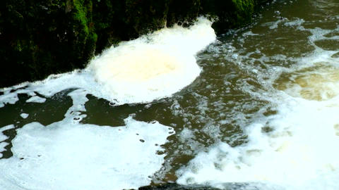 Turning of foam on dirty water bellow rapids. Terrible smell muddy water. Stony  Footage