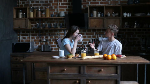 Happy couple spending morning together in kitchen Footage
