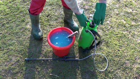 Agriculture sprayer sprinkler in spring garden and chemicals Live Action