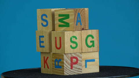 Rotating wooden cubes with alphabetical letters Footage