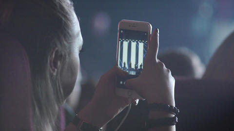 Girl shoots a concert video on a mobile phone Live Action
