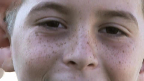 happy face expression of a young child with freckles Footage