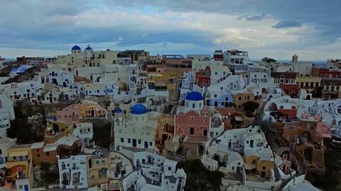 Flying over the white houses of Santorini, Greece Filmmaterial