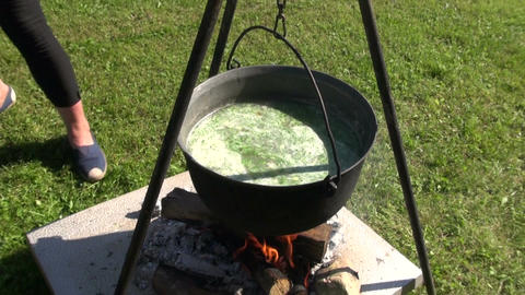 Boiling soup outdoors Footage