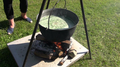 Soup cooking in medieval fair Footage