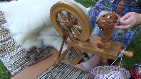 Respectable age woman using spinning wheel Footage