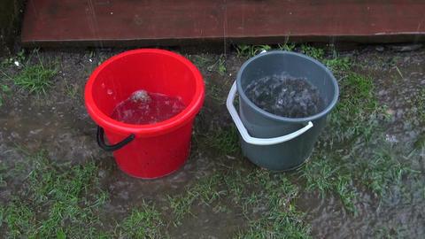 Rain water running into buckets Footage
