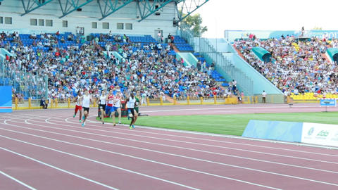Exciting Running Competition on Stadium at Universiade Footage