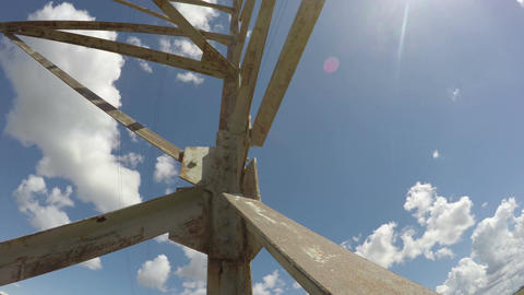 Electrical pylon against blue cloudy sky, time lapse 4K Footage