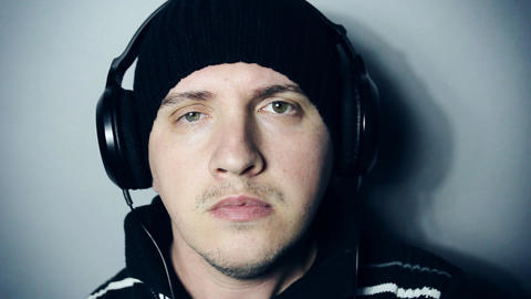 Portrait of man who is listening to music while wearing headphones Footage