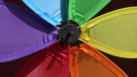 Background of rainbow windmill turning, 4K Footage